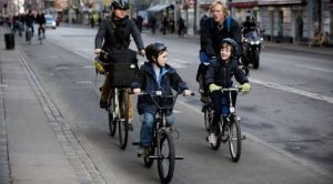 ** ADVANCE FOR STORY SLUGGED DENMARK GREEN DANES ** In this file photo a Danish family rides the cycle path in center Copenhagen. The Danes are climate-conscious and have changed their daily habits to reduce CO2 emissions. Advice include: take short showers, hang your laundry out to dry, use energy-efficient light bulbs, bicycle to work and eat less meat and more vegetables. (AP PHOTO/POLFOTO, Tariq Mikkel Khan, file) ** DENMARK OUT ** AP FILE TO GO WITH STORY BC-EU--Denmark-Green Danes BY JAN M. OLSEN